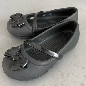 Girls size 11, black Mary Jane Crocs with bow.